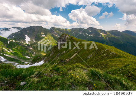 valley with snow in summer mountains 38490937