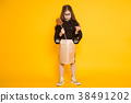 Little girl with lollipop 38491202