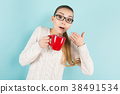 Attractive woman with ponytail and cup 38491534