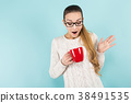 Attractive woman with ponytail and cup 38491535