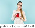 Attractive woman with ponytail and cup 38491538