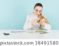 Attractive woman with cash and magnifying glass 38491580