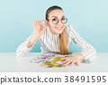 Attractive woman with cash 38491595