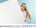 Attractive young woman with blank banner 38491670