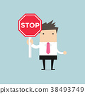 Businessman showing stop road sign. 38493749