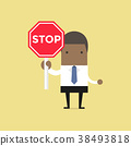 African businessman showing stop road sign. 38493818