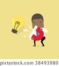 African businessman attracting light bulbs. 38493980
