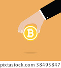 Businessman Hand Holding Bitcoin. 38495847