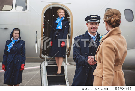 Outgoing pilot greeting with female 38498644