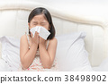 Asian girl blowing the nose by tissue 38498902