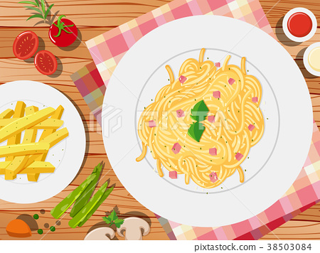 Spaghetti and frenchfries on the table 38503084