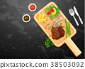 Lambchop and vegetables on wooden board 38503092