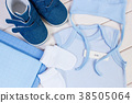 Pregnancy test with positive result and clothing 38505064