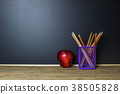Education concept. Pencil and red apple on table 38505828