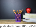 Education concept. Pencil on table and red apple 38505859