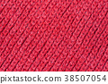 Texture of knitted red sweater 38507054