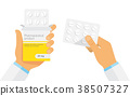 Doctor holding blister pack of pills in hands. 38507327