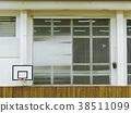 Basket ball hoop in empty basketball court 38511099