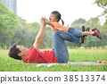 Asian father and his daughter playing together. 38513374