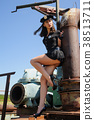 Sexy attractive police woman near metal tubes 38513711