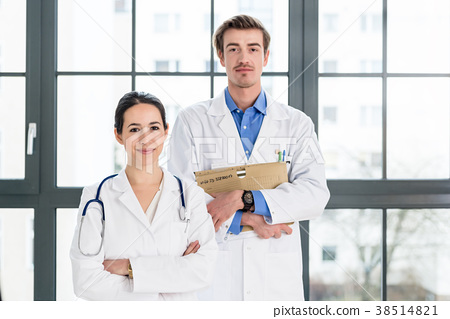 Portrait of two determined physicians looking at 38514821
