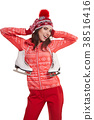 Pretty woman ice skating winter sport activity in white cap smil 38516416