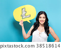 Litecoin with woman holding a speech bubble 38518614