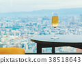White wine on a table above the city 38518643