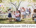 Family celebration or a garden party outside in 38521541
