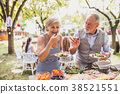 Family celebration or a garden party outside in 38521551