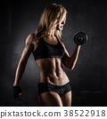 athletic woman with dumbbells 38522918