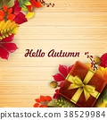 Autumn leaves gift box with ribbon and bow 38529984