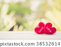 Red heart on wood table top blur bokeh background 38532614