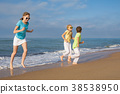 person, playing, beach 38538950