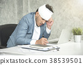 Businessman headache and bandage from work injury  38539501