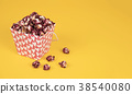 Pink popcorn with berry taste in paper cup on 38540080