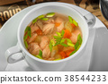 Transparent soup with chicken, carrots and greens 38544233