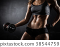 athletic woman with dumbbells 38544759