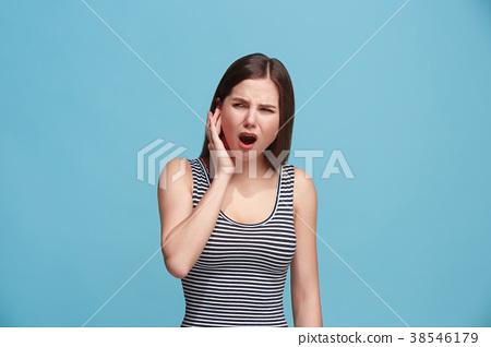 The Ear ache. The sad woman with headache or pain