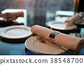 Table setting at a restaurant with a sunset 38548700