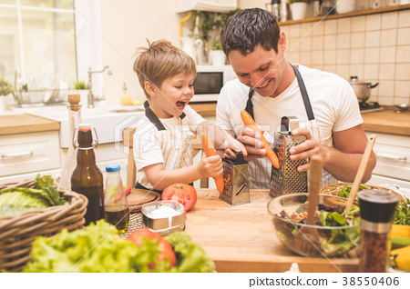 Father is cooking with his son 38550406