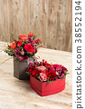 Two red boxes with flowers and gingerbread hearts 38552194