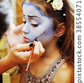 little cute child making facepaint on birthday 38554071