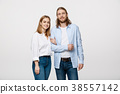 Portrait of attractive young couple smiling for 38557142