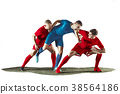 Football players tackling for the ball over white 38564186