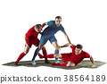 Football players tackling for the ball over white 38564189