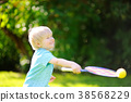 Kid playing badminton in summer park 38568229