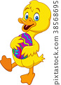 Cartoon duckling holding a decorated Easter egg 38568695