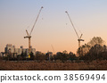 two tower cranes on sunet 38569494