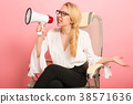 Angry businesswoman with loudspeaker 38571636